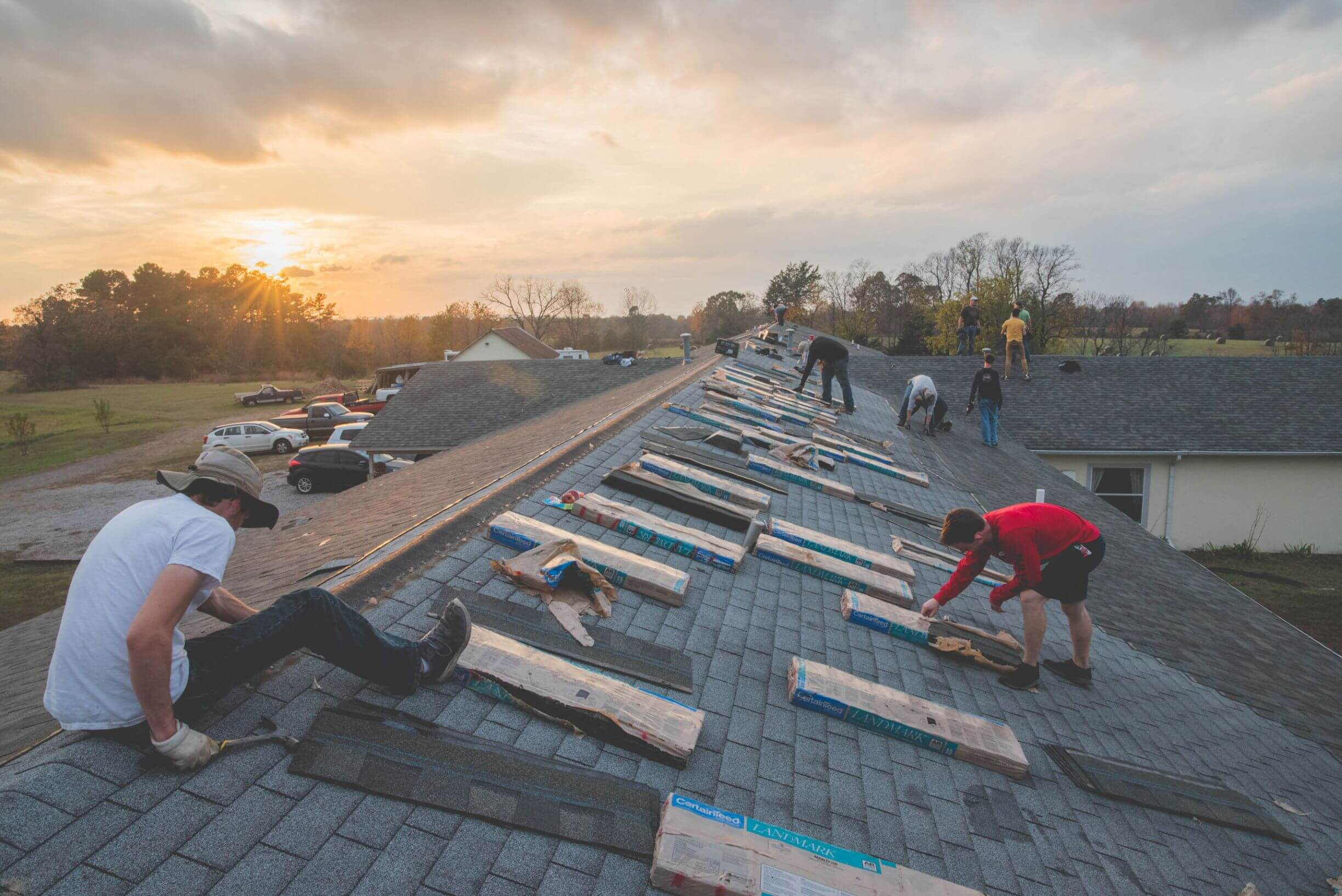 Group of Students working on a roof