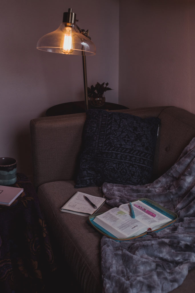 In the prayer room, a Bible and a journal during personal devotions