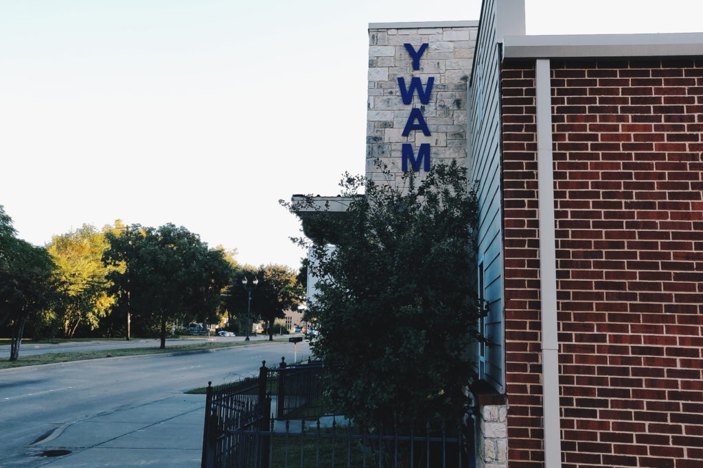 YWAM sign outside of YWAM Wylie main building in Wylie, Texas. The building is located on Ballard Avenue right next to Downtown Wylie.