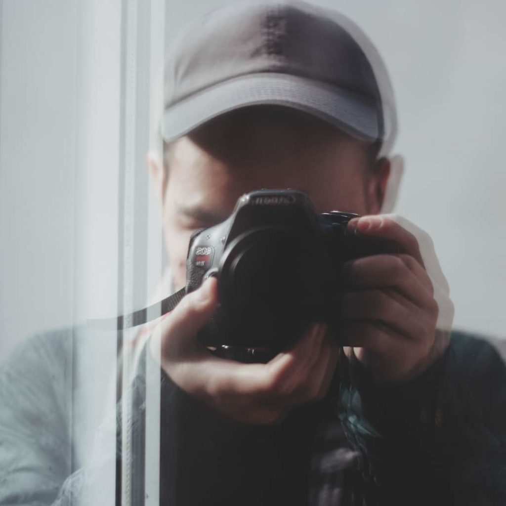 Mirror photo of Joseph, a Photography & Storytelling Track student